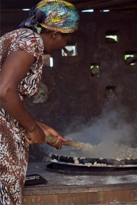 Alice from Pader stirring lunch for hundreds of girls