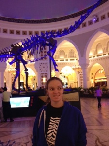 Liz inside the mall, not really interested in the dinosaur.