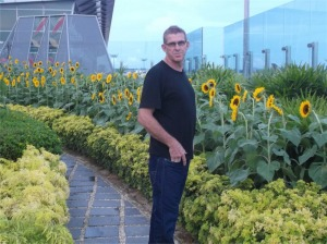 Pete with the sunflowers at the airport.