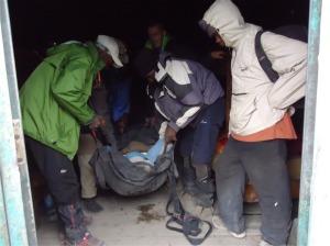 Pete being walked down Mt Kilimanjaro with a broken leg.
