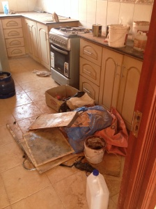 How the flooring guys had left the kitchen.